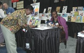 Ifeoma signs a book for a US fan of her work